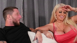 Busty blonde deepthroat on the couch