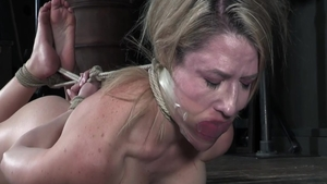 Busty blonde really enjoys torture