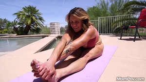 Bends over outdoors HD