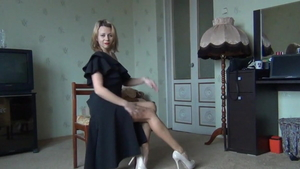 Tight blonde haired wearing high heels softcore teasing