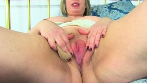Masturbating in company with huge MILF