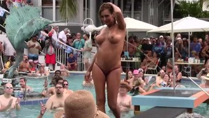 Brunette reality masturbating in the pool